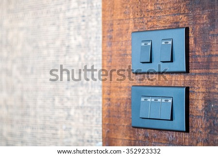 light switch on wooden Background