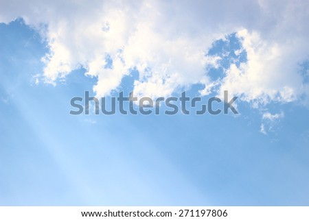 Light through clouds with blue sky background - stock photo