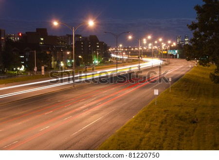 Light traffic on the highway at night at long exposure. - stock photo
