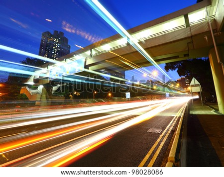 light trail in city at night - stock photo