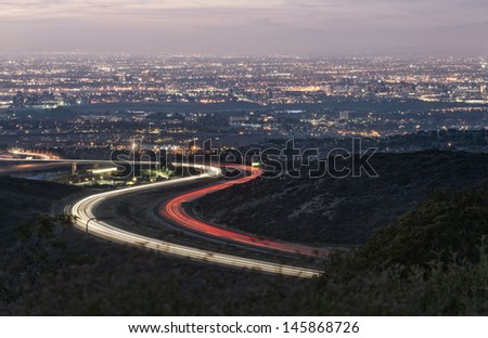 light trail with city background - stock photo