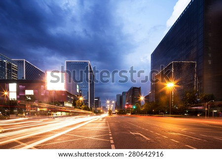 light trails in modern city street - stock photo