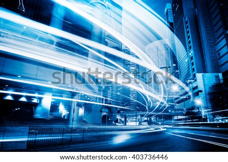 Light trails in the downtown district,hong kong - stock photo