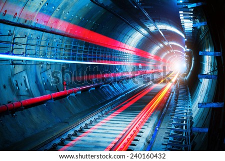 Light trails in the subway tunnel - stock photo