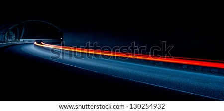 light trails in tunnel. Art image . Long exposure photo taken in a tunnel