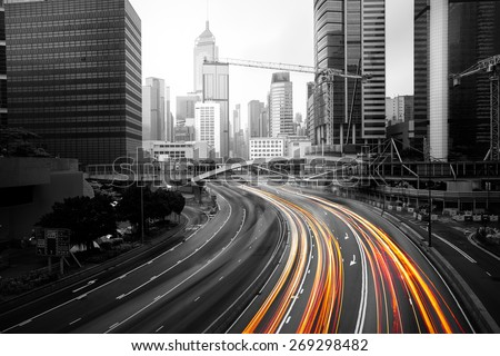 Light trails of cars In motion blur on road Hong Kong China - stock photo