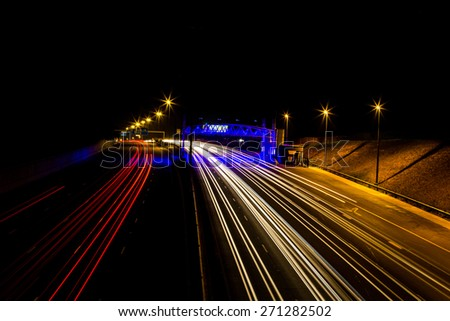 Light trails of fast cars on a high way.