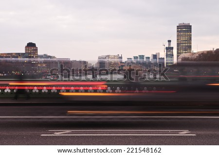Light trails of passing cars on a bridge in London - stock photo