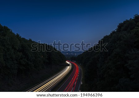 light trails on a freeway highway at night  - stock photo
