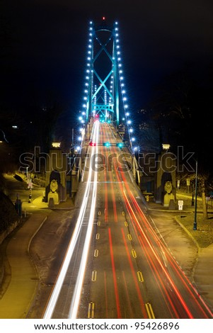 Light Trails on Lions Gate Bridge in Vancouver BC Canada at Night - stock photo