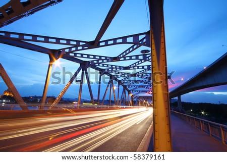 light trails on the bridge - stock photo