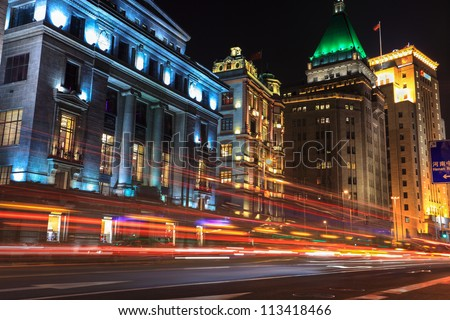 light trails on the bund at night in shanghai