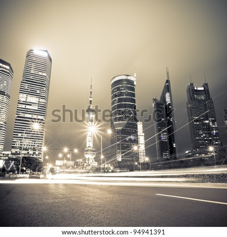 light trails on the century avenue at night in shanghai,China - stock photo