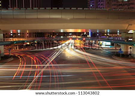 light trails on the crossroads at night in shanghai - stock photo