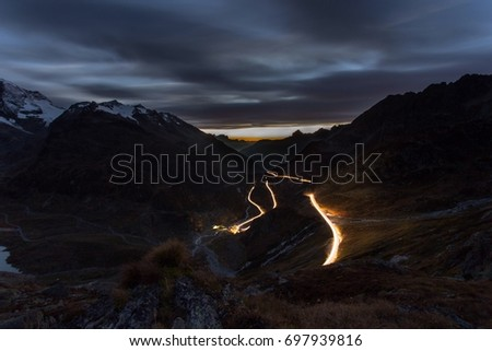 Light trails winding up the hill