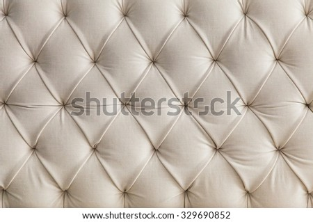Light upholstery white sofa pattern background - stock photo