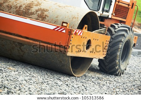 Light Vibration roller compactor at road construction and repairing asphalt pavement works - stock photo