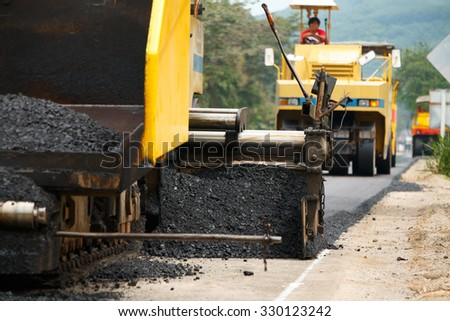 Light Vibration roller compactor at road under construction and repairing asphalt, Road making. - stock photo