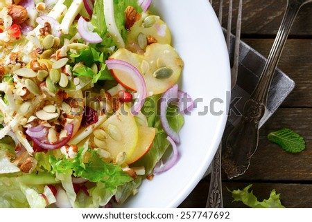 Light winter fruit salad on a plate, vegetarian food. Top view - stock photo