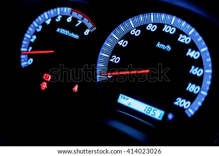 light with car mileage with black background