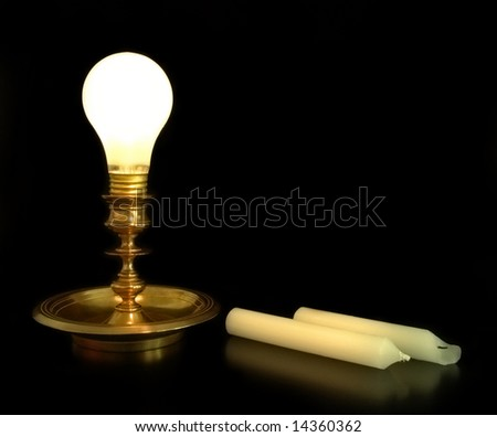 lightbulb in a candlestick - stock photo
