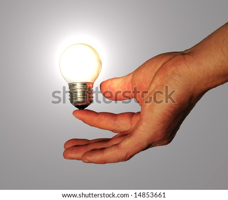 lightbulb powered by human - stock photo