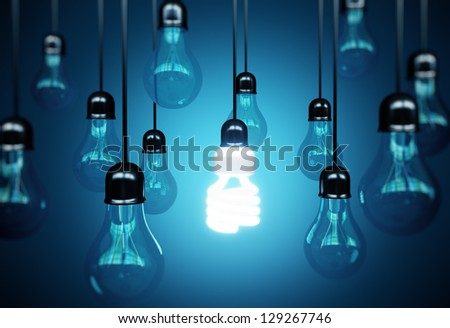 lightbulbs on blue background, idea concept - stock photo