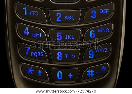 lighted dial of a cell phone keypad - stock photo