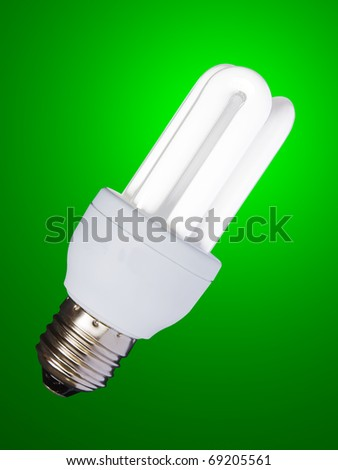 lighted lamp, low consumption fluorescent bulb on high efficiency and energy saving, isolated with clipping path - stock photo