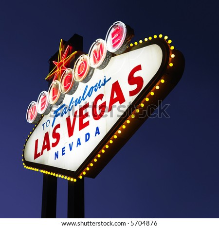 Lighted Las Vegas welcome sign with night sky. - stock photo