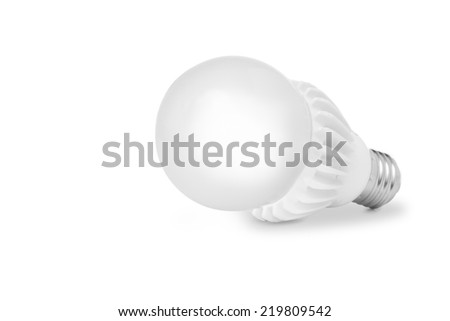 Lighted LED bulb on a white background - stock photo