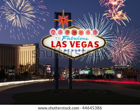 Lighted sign reading Welcome to Fabulous Las Vegas Nevada with fireworks in background. Horizontally framed shot. - stock photo