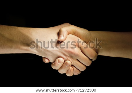 Lighted two hands unite with eachother as agreement - stock photo