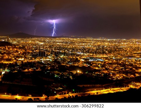 Lightening strike over the city of Queretaro Mexico. In this picture you can see can clearly Los Arcos a historic landmark of the historic town.  - stock photo