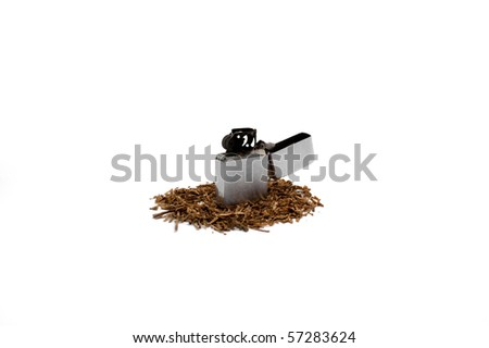 Lighter and heap of tobacco - stock photo