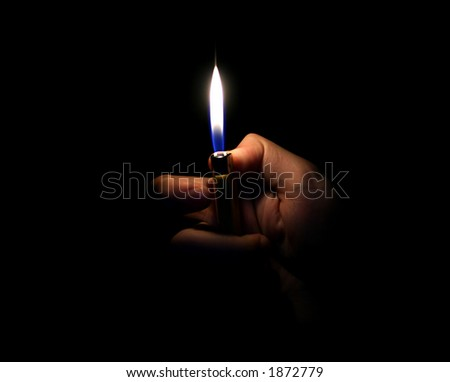 Lighter in a hand isolated on black