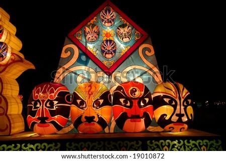 lightful Chinese faces in chinese lantern festival celebrating new year - stock photo