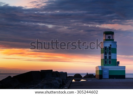 Lighthouse and a sunset - stock photo