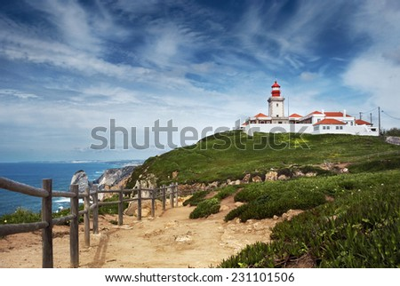 Lighthouse and Atlantic ocean at cabo da Roca, Portugal - stock photo