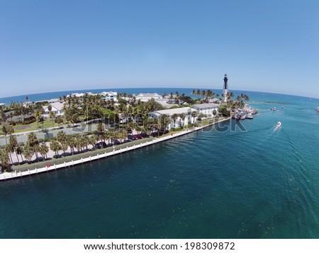 Lighthouse and boating inlet on coast of Pompano Beach, Florida - stock photo