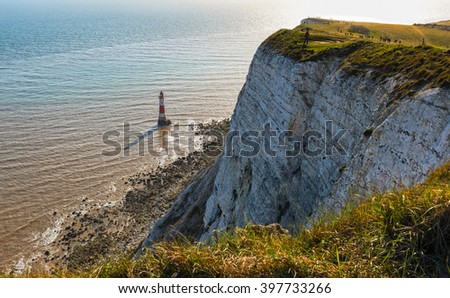 Lighthouse and chalk cliffs at Beachy Head, East Sussex, United Kingdom - stock photo