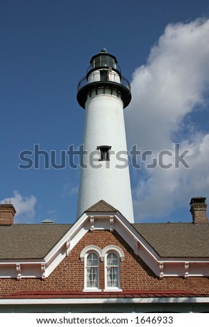 Lighthouse and roof of brick building