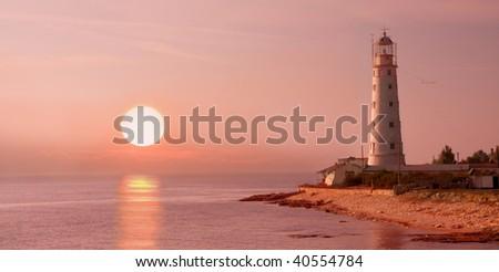 lighthouse and sunset - stock photo