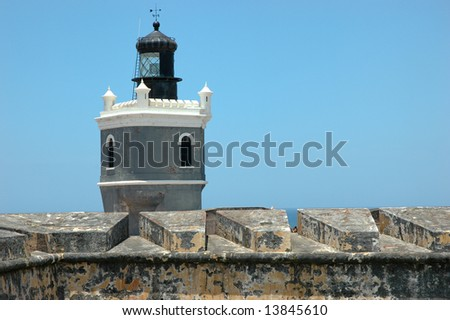 Lighthouse and Turret at Castillo el Morro in Old San Juan, Puerto Rico - stock photo
