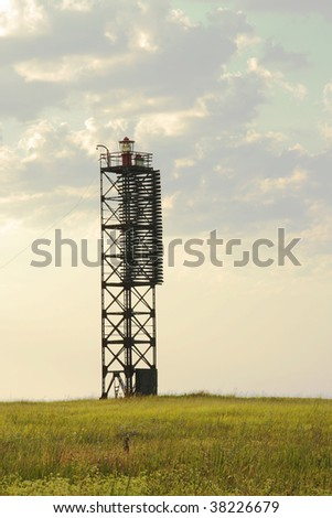 lighthouse at a sunset - stock photo