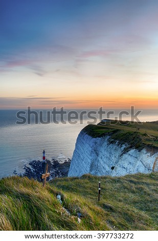 Lighthouse at Beachy Head, East Sussex, at sunset - stock photo