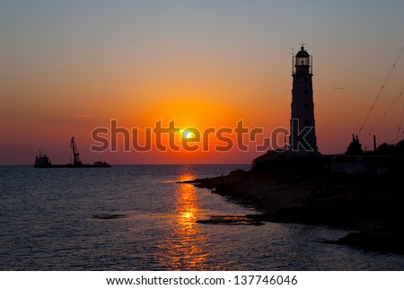 Lighthouse at Cape - stock photo
