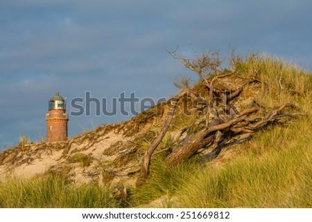 lighthouse at Darss Peninsula in Germany at sundown - stock photo