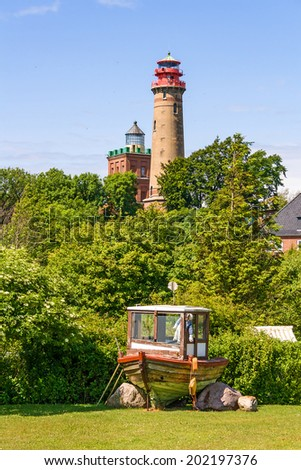 Lighthouse at Kap Arkona with old boat in front, Island of Ruegen, Germany - stock photo