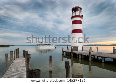 Lighthouse at Lake Neusiedl at sunset inPodersdorf, Burgenland, Austria - stock photo